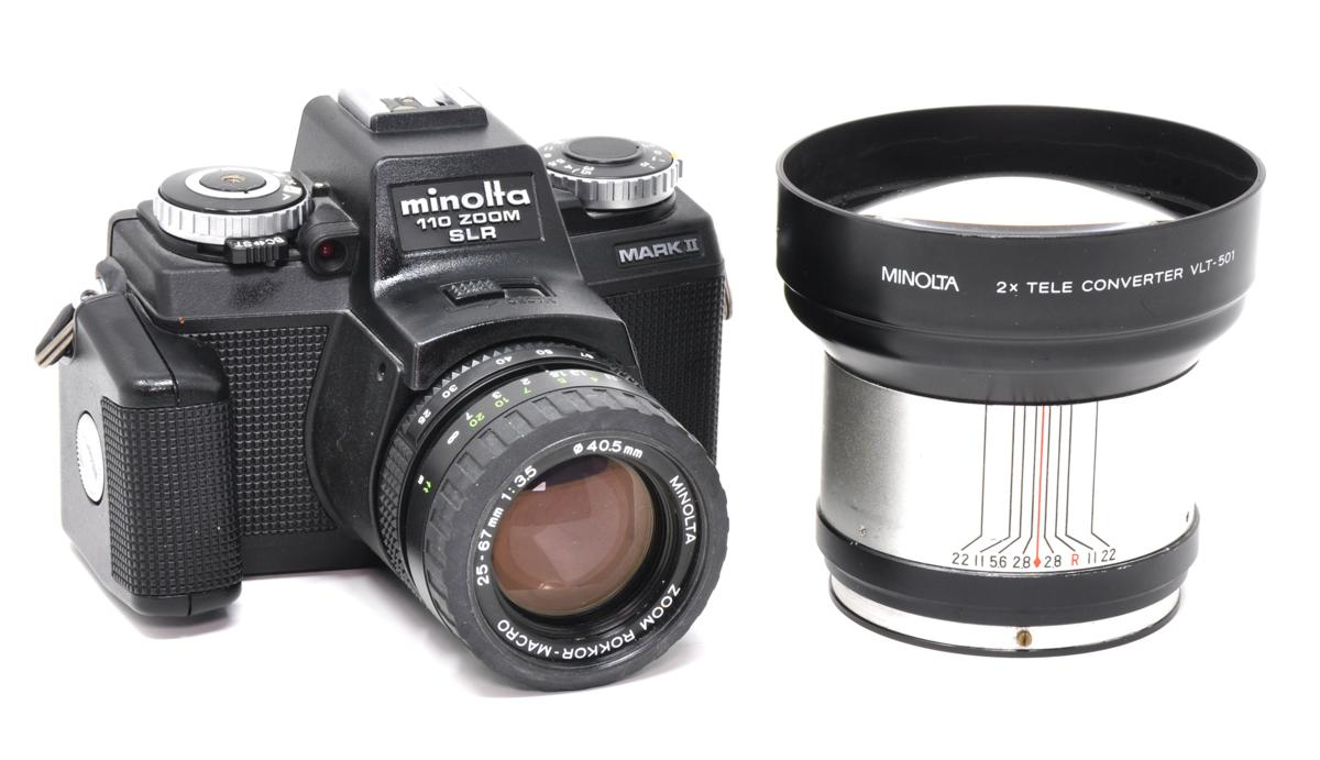 The Minolta 110 Zoom SLR Mark II with its rare teleconverter - 110 film cameras