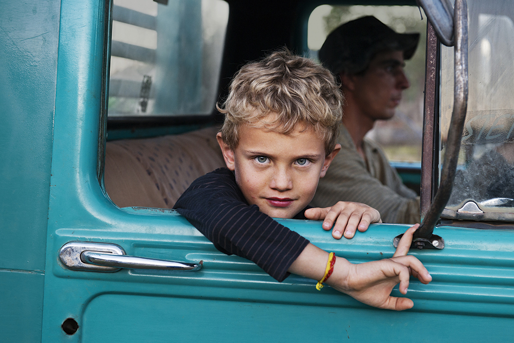 A farmer's son in his father's truck, Steve McCurry