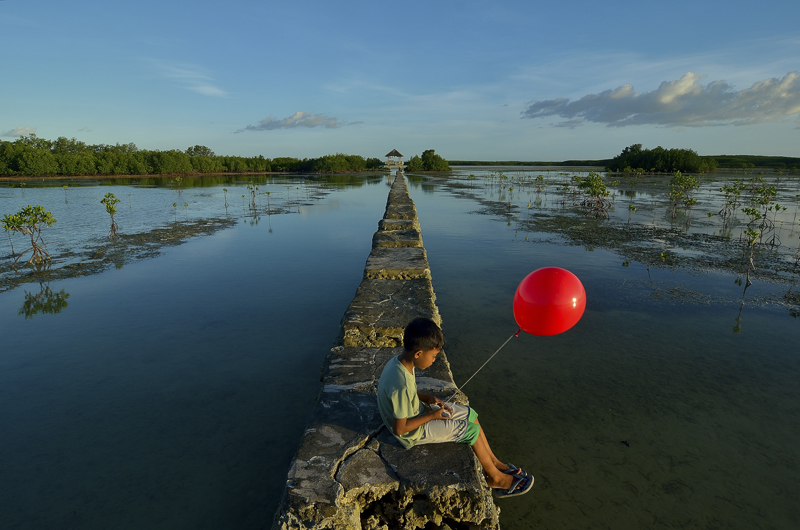 Boy witha Red balloon by Anthony Into Manilla Philippines