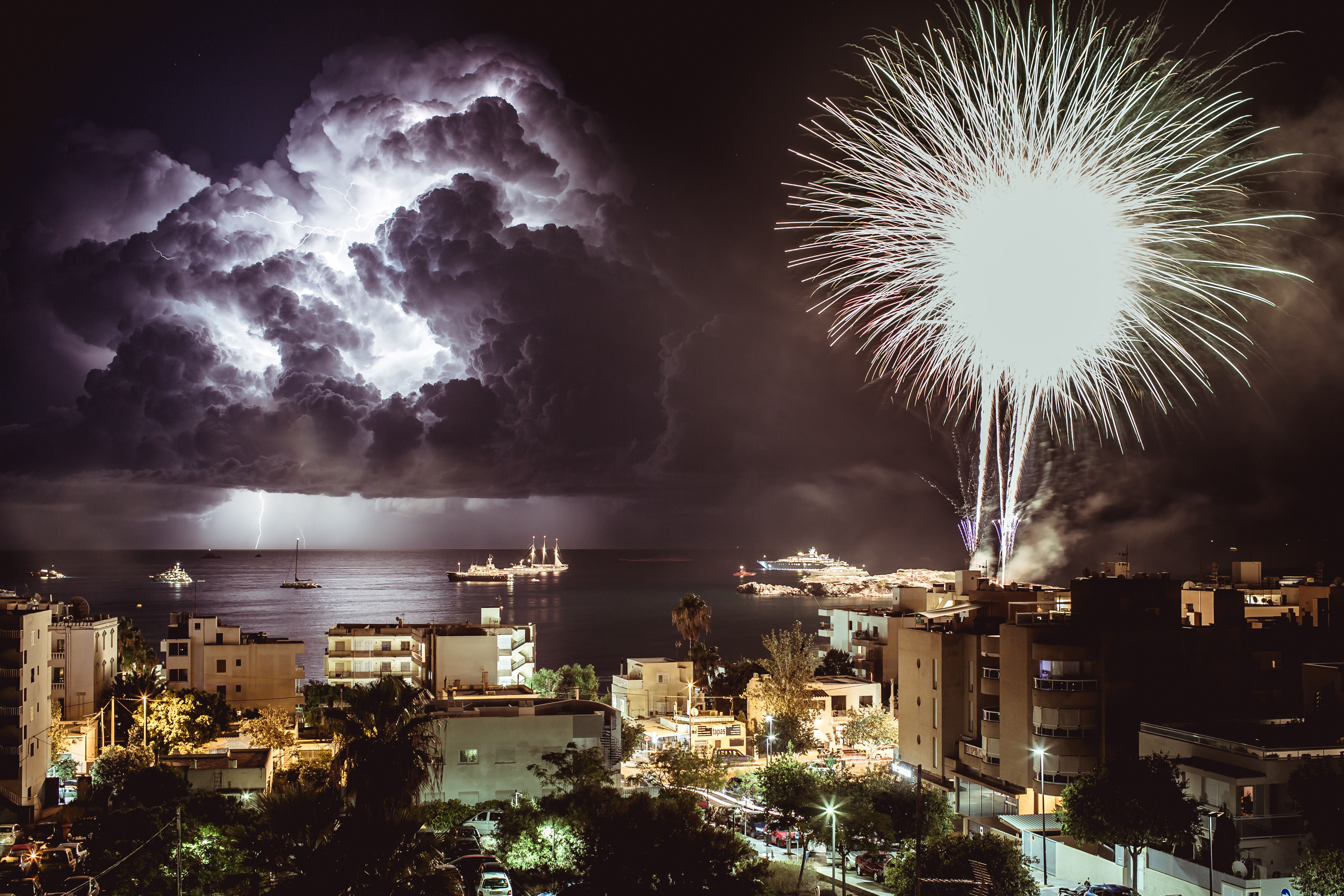 Photographer captures awesome 'Man Vs Nature' moment as lightning strikes during storm in Ibiza