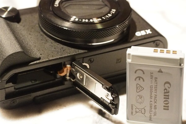 The NB-13L sits next to the SD card and is good for 210 shots per charge, or 215 using the EVF