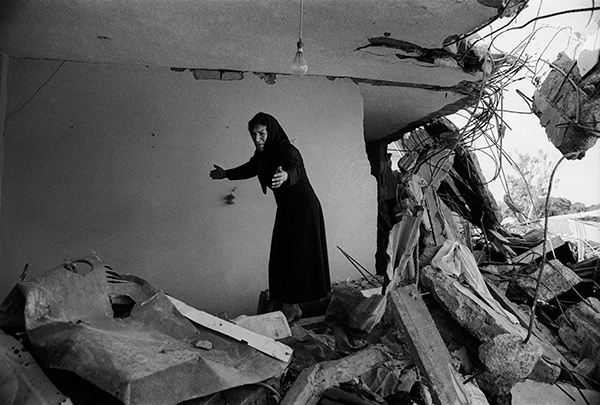 Photo London 2016 A Palestinian Woman Returning to the Ruins of her House, Sabra, Beirut, 1982 © Don McCullin, courtesy Hamiltons Gallery, London