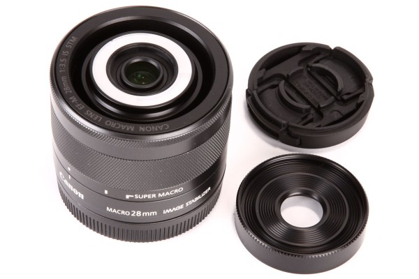 The full kit includes the lens, screw-on filter adapter, and custom front cap