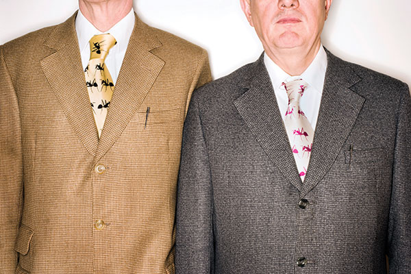 The suits, formal pose and Parker pens identify this pair as Gilbert & George