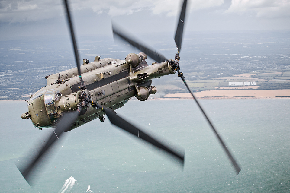 2015-07-22. The Solent, Southern England, United Kingdom. Pictured: A 27 Sqn Chinook makes a hard bank over The Solent during a Aircraft Handling Exercise to assess the development of new Pilots and Aircrew. As part of a 2-day Training Exercise, 27 Sqn, based out of RAF Odiham flew several sorties over Southern England and the Channel to assess the handling standards and flying abilities of their Aircrew and Pilots. Operating the Mk4 Chinook, the crews participated in several scenarios, including confined spaces landing, flying over the sea, low level flight and underslung loads. These sorties incorporated formation flying, which enabled Service air-to-air photography and experience flights for station personnel. SAC Nicholas Egan is an RAF Photographer currently based out of RAF Odiham, Hampshire. He joined the Royal Air Force in 2011, and following his time at the Defence School Of Photography at Cosford, was posted to Aldergrove Flying Station in Northern Ireland. Following his two years spent in Northern Ireland, he was posted to RAF Odiham in January 2015. Photographers details: SAC Nicholas Egan. Photographic Section | RAF Odiham | Hook | Hampshire | RG29 1QT 01256 367289 |