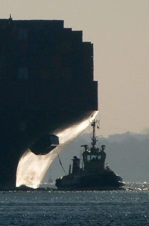 The winning image. Lord Greenway's atmospheric backlit mage of a tugboat and cargo ship was the unanimous favourite of the judges