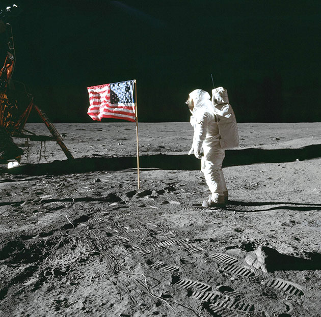 NASA Buzz Aldrin with flag