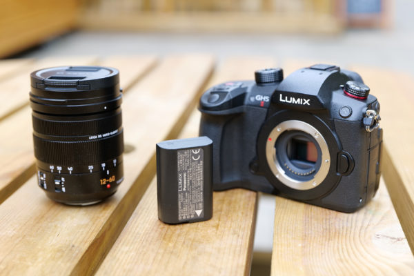 Panasonic Lumix GH5 II with lens and battery