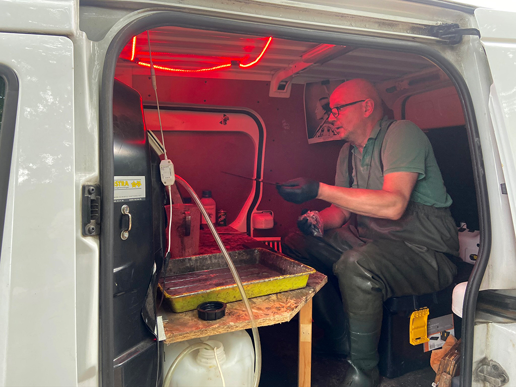 Photographer Alex Timmermans in a van, developing wet-plate prints