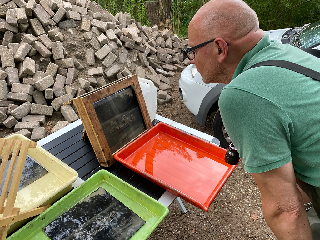 Alex inspecting developed wet-plates in the field