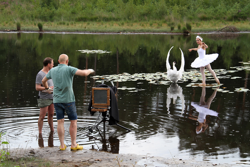 Photographer Alex Timmermans taking wet-plate photo of ballerina and swan on a lake