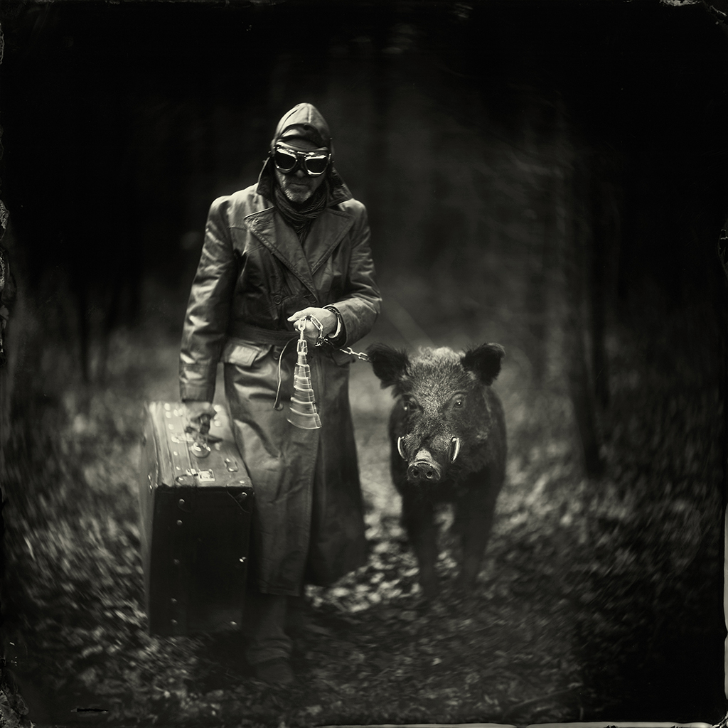 Black and white photo of person with a boar