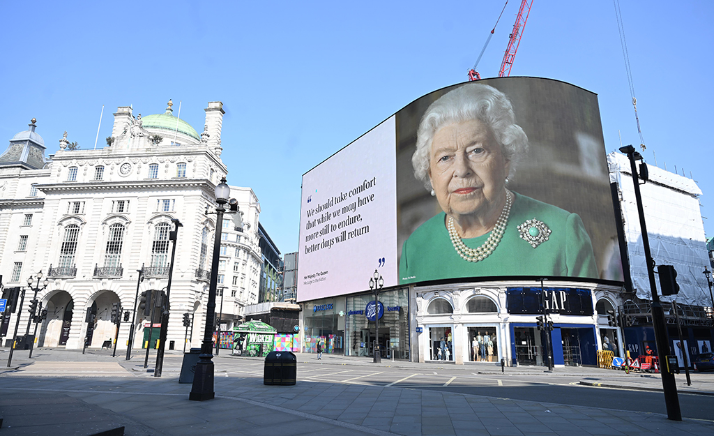 Image of empty piccadilly circus screen showing Queen Elizabeth II during pandemic