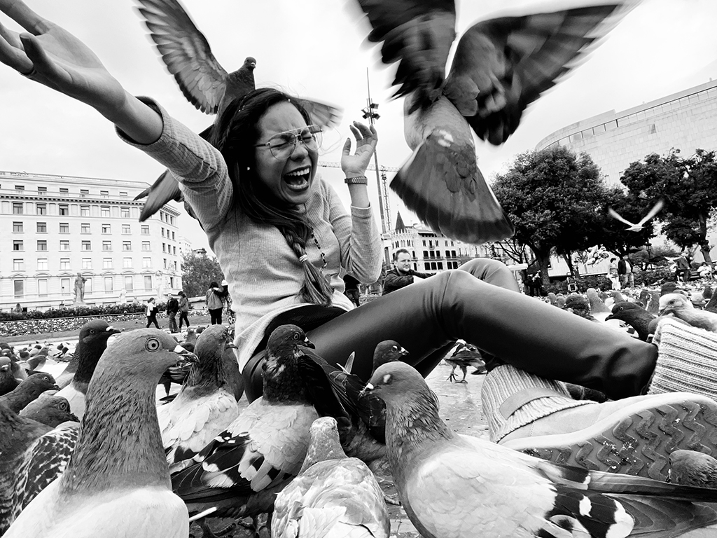 street photograph with smartphone woman and pigeons
