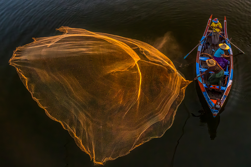 fishermen cast their nets on the Irrawaddy River in Mandalay, Myanmar