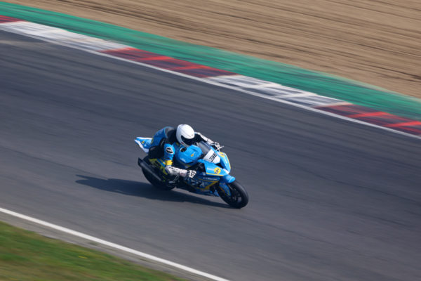 Canon EOS R3 motorcycle racing sample image with panning